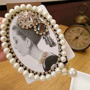 103B-5  Hepburn with fresh pearls